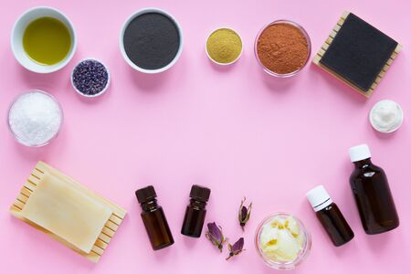 Frame from aromatic spa set products on pink background. flat lay, top view. Concept self-care at home with copy space.