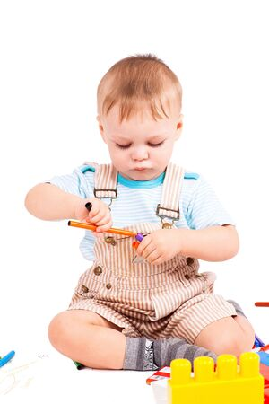 Two years boy collects constructor against the white background Stock Photo - 12290111