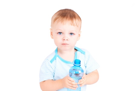 Two years boy holds a bottle of water photo