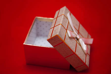 open gift box with ribbon on a red background Stock Photo - 12290109