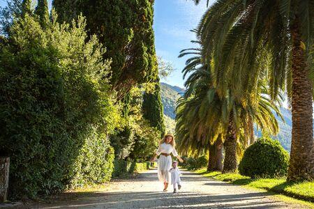 A little girl runs away from her mother .