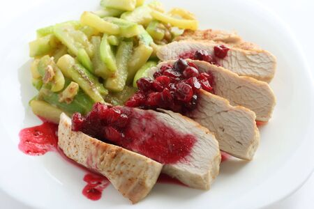 Turkey with cranberry sauce and fried marrow