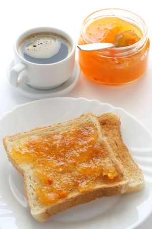 Toast with jam and a cup of coffee photo
