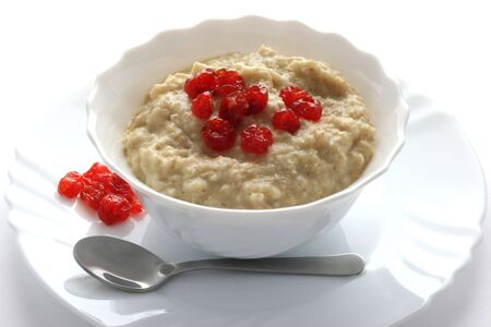 Porridge with dried cherries and a spoon