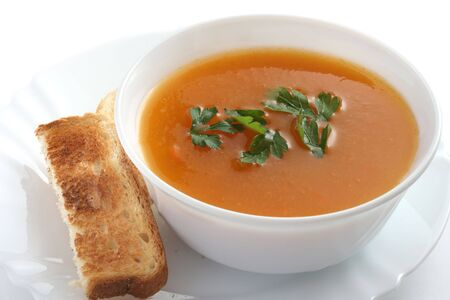 pumpkin soup in the white bowl with toast Stock Photo