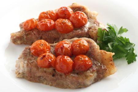 tomato cherry: Fried pork with tomato cherry