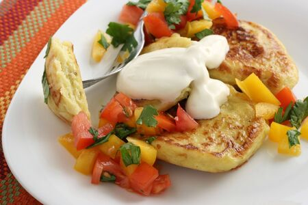 potato cakes with pepper and sour cream