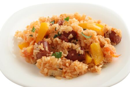 rice with sausage and pepper on a plate Stock Photo