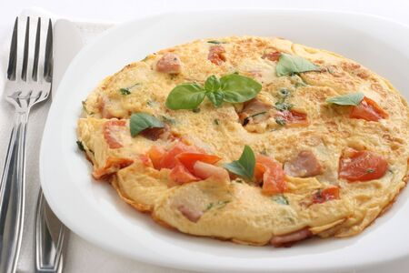 Omelet with tomato and ham Stock Photo