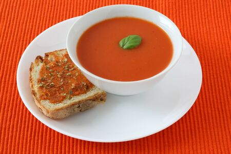Tomato soup with toast photo