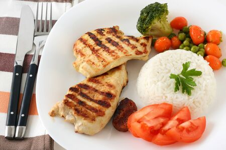 grilled chicken with rice and vegetables