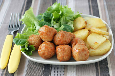 chicken meatballs with potato and salad