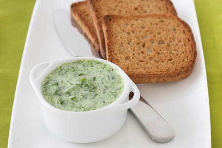 spinach sauce with toasts Stock Photo