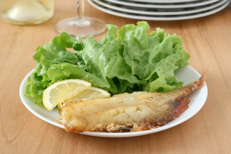 redfish: fried red-fish with salad Stock Photo