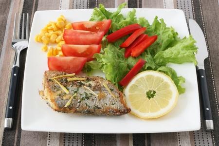 fried swordfish with salad Stock Photo - 9730593