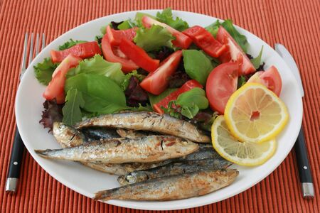 fried sardines with salad photo