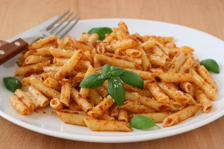 penne with sauce and basil photo