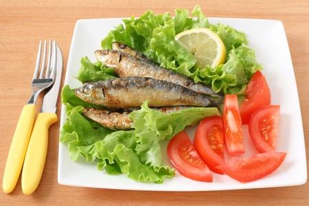 fried sardines with salad photo
