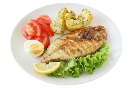 fried fish with potato and lemon Stock Photo - 10625216