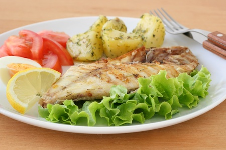 fried fish with potato and lemon Stock Photo
