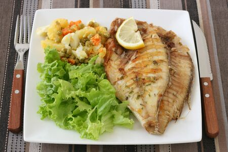 fried fish with salad  and vegetables Stock Photo - 10625211