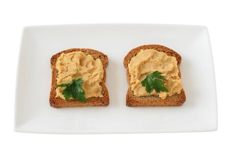 toasts with hummus Stock Photo
