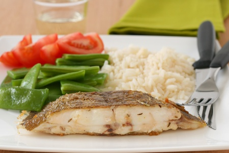 fried flounder with rice and vegetables Stock Photo
