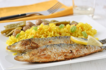fried sardines with rice and vegetables photo
