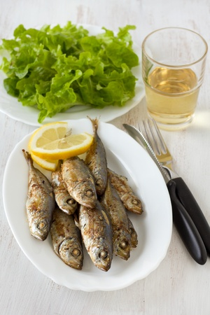 fried fish with lemon photo
