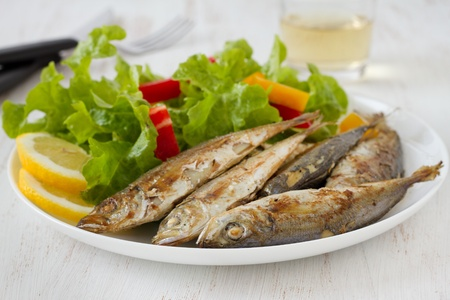 fried fish with lemon and salad photo