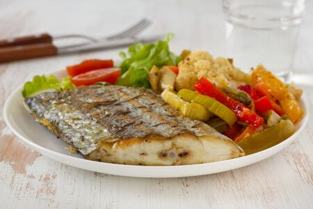 fried swordfish with vegetables photo