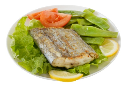 fried swordfish with salad and green beans photo