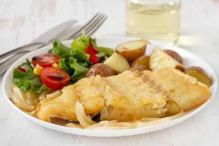 codfish with potato and vegetable salad