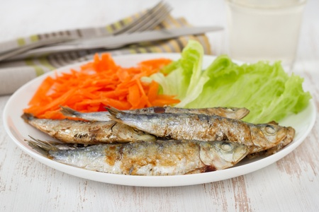 fried sardines with lettuce and carrot on the plate Stock Photo - 13728309