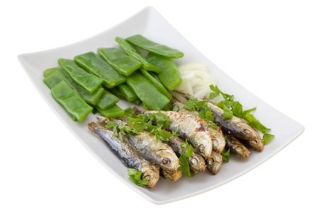 fried sardines with boiled green beans and onion photo