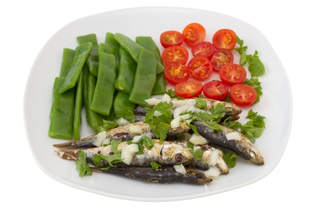sardinas fritas cocidas con jud�as verdes y tomate photo