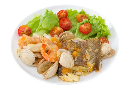 fish stew with salad on the white plate Stock Photo