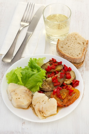 boiled fish in sauce with vegetables Stock Photo