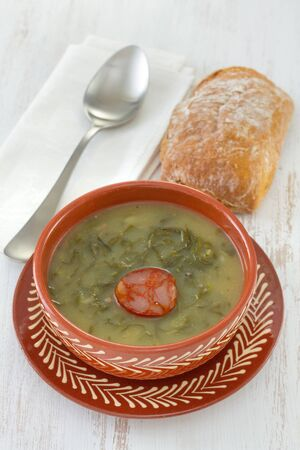 caldo verde in brown bowl and bread Stock Photo
