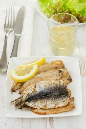 fried fillet of sardines with lemon photo