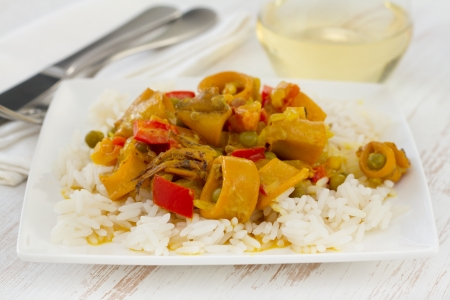 squid with peas and pepper in curry sauce with boiled rice photo