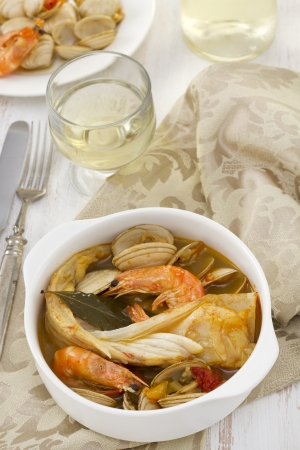 fish with seafood and vegetables in white bowl Stock Photo - 15537636
