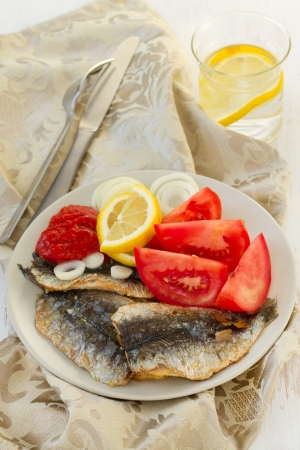 filet of sardines with lemon and tomato photo