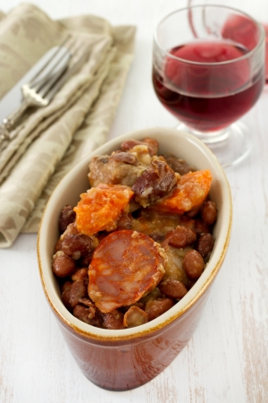 sausages and meat with red beans photo