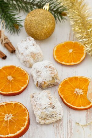 Christmas cakes and dry orange photo