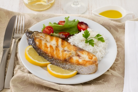 grilled fish with rice, lemon and salad