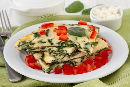 omelet with spinach, cottage cheese and red pepper photo
