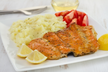 salmon with mashed potato and tomato photo