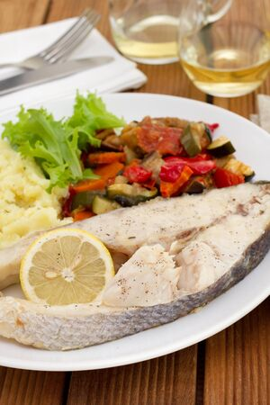 perca: boiled fish with vegetables, salad and mashed potato