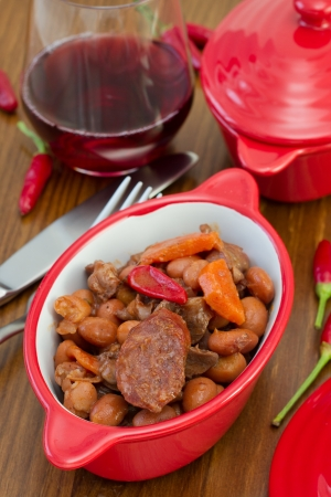 sausages with meat and beans in the bowl photo